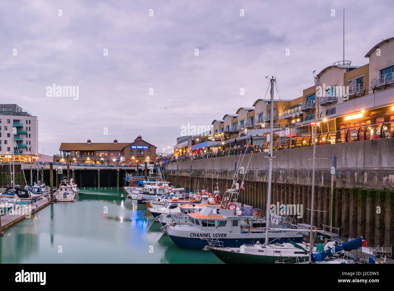 Brighton, England. 13 April 2017.Boats, yachts, and fishing boats moored at Brighton Marina docs on a cloudy day. Stock Photo