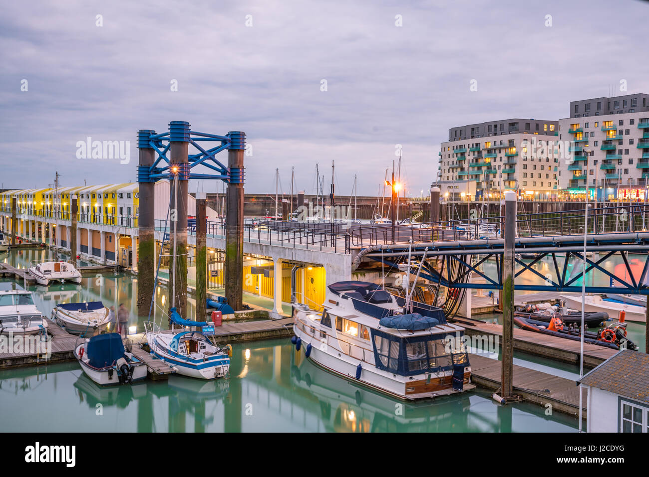 Brighton, England. 13 April 2017.Boats, yachts, and fishing boats moored at Brighton Marina docs on a cloudy day. Stock Photo