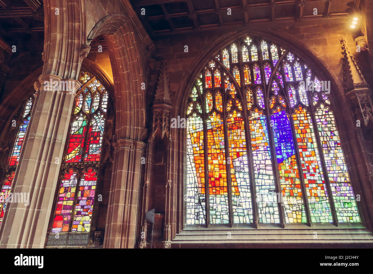 Beautiful stained glass windows and colums of the Manchester Cathedral in UK - Stock Image