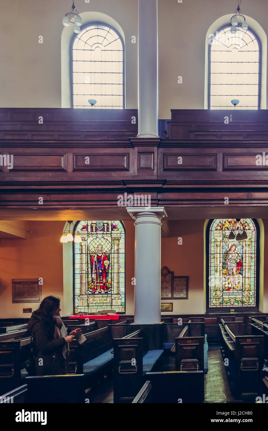 Beautiful stained glass windows and benches of St Anns Church in Manchester, UK Stock Photo