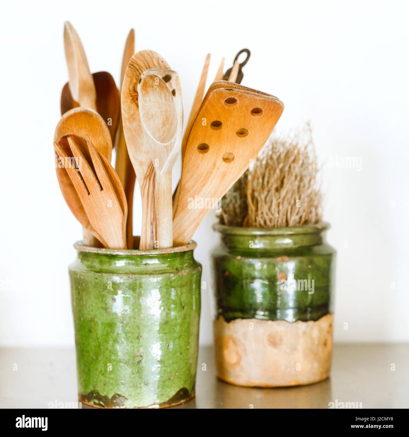 Assorted kitchen utensils in vase. - Stock Image