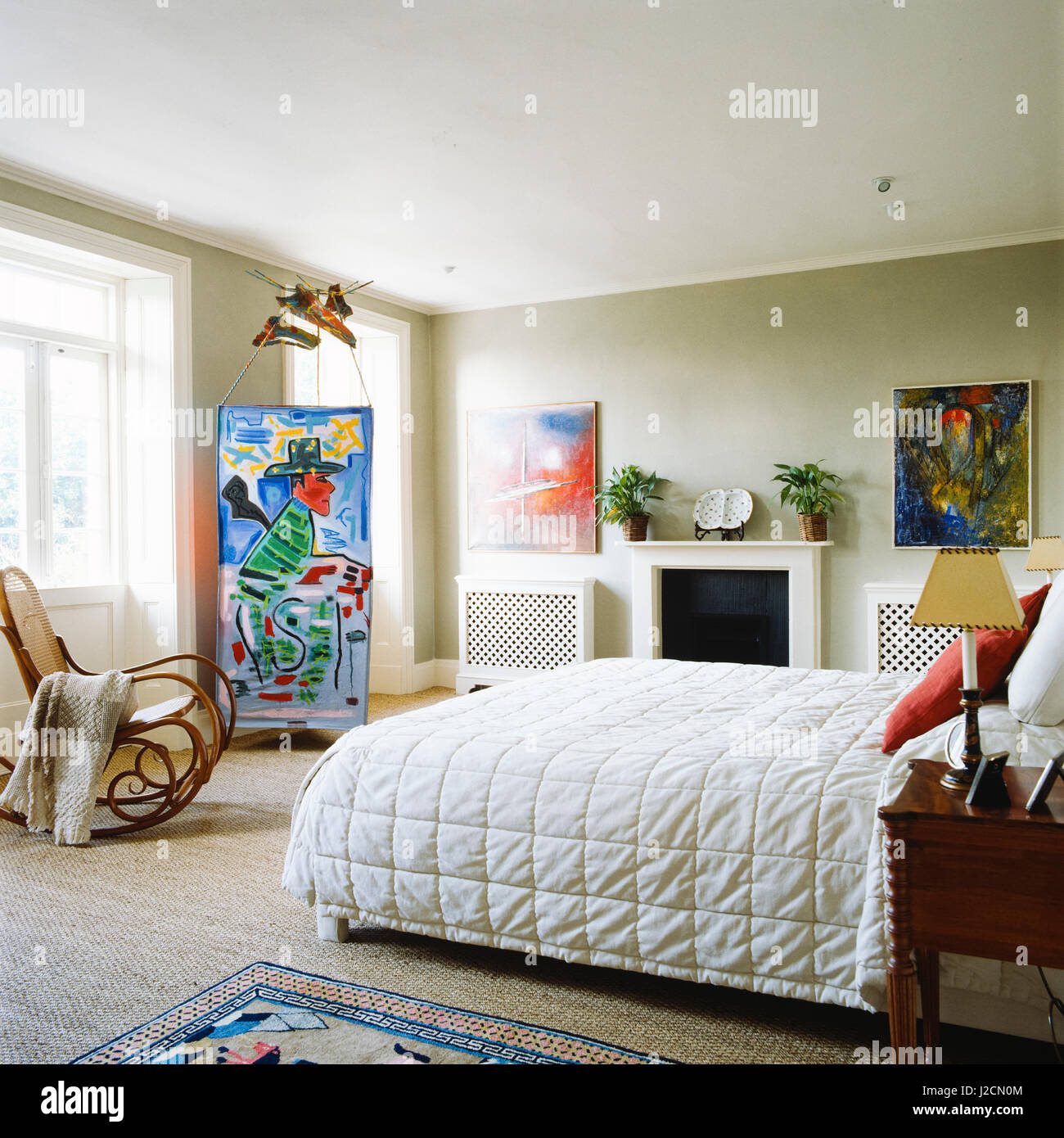 Bedroom decorated with contemporary art. - Stock Image
