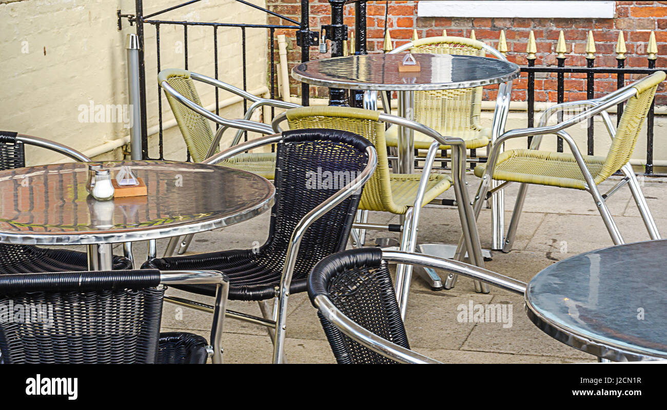 Metal tables and wicker chairs, restaurant front, restaurant garden, catering industry, outside - Stock Image