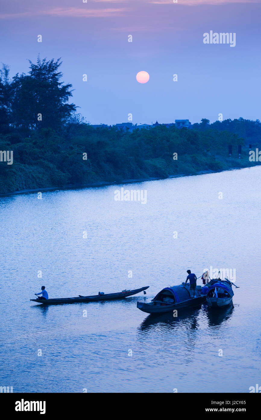 Vietnam, DMZ Area. Dong Ha, Cam Lo River, boats at sunset - Stock Image