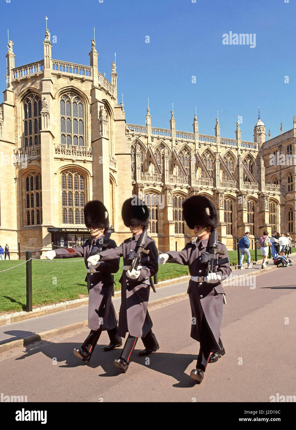 St Georges Chapel Windsor Castle Berkshire England UK British Army Grenadier guardsmen soldiers marching in winter - Stock Image