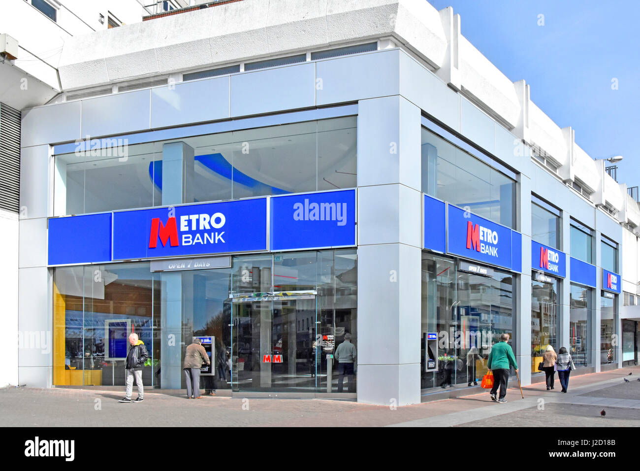 Metro Bank branch signs and logos on a corner site High Street Southend on Sea Essex England UK atm cash point machines - Stock Image