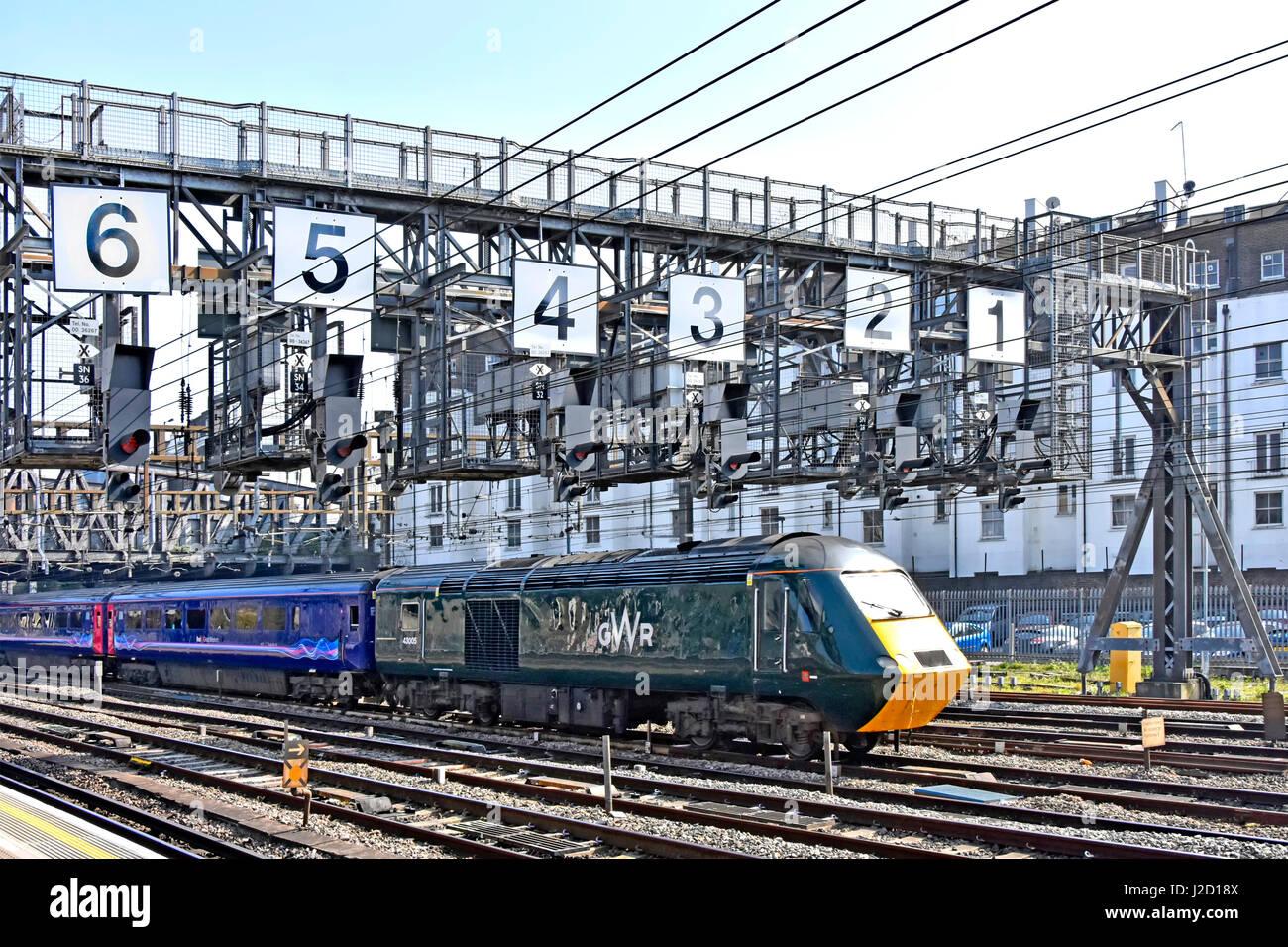 Train rail tracks UK GWR loco railway tracks & First Great Western train just departing London Paddington below - Stock Image
