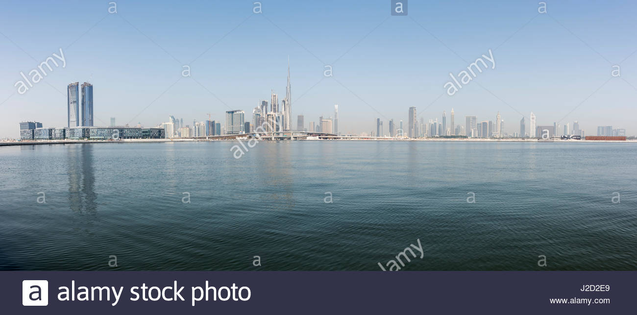 Dubai Skyline with the water canal, Dubai Design district (left) and Burj Khalifa the iconic skyscraper, Ras Al - Stock Image