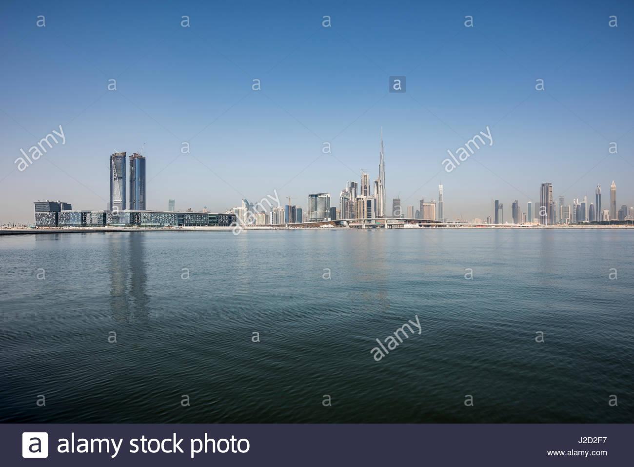 Dubai Skyline with the water canal, Dubai Design district (left) and Burj Khalifa the iconic skyscraper, Ras Al - Stock Image
