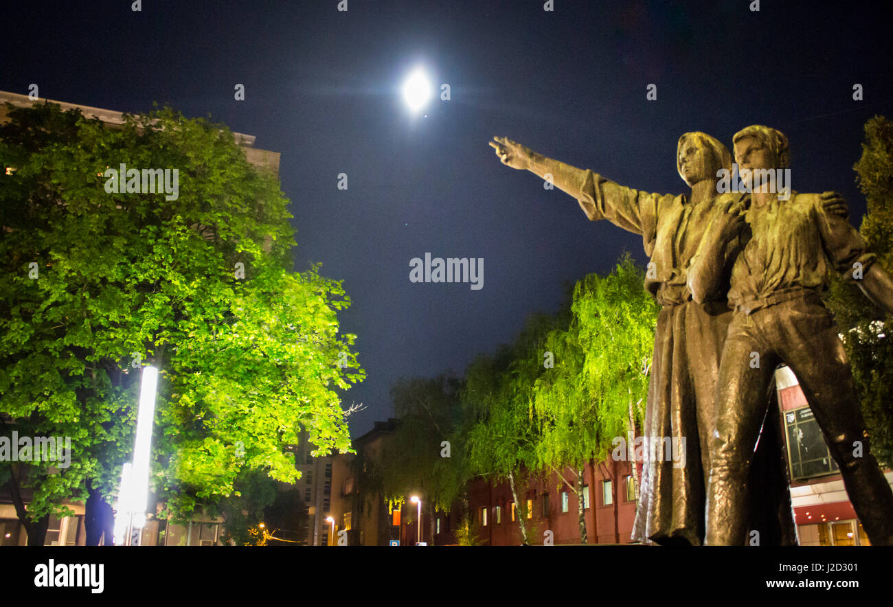 Sculpture at entrance of Belgrade Drama theater pointing to the shining moon on a bright night sky - Stock Image
