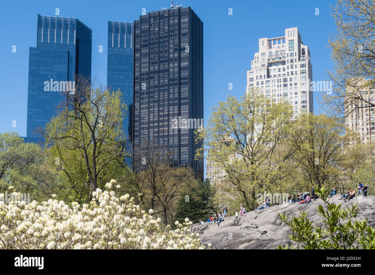 Towers Along Central Park West behind Rat Rock,C entral Park in Springtime, New York City, USA - Stock Image