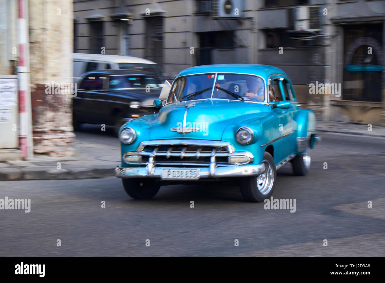 West Indies, Cuba, Havana. Well-preserved vintage car in motion. Credit as: Nancy & Steve Ross / Jaynes Gallery - Stock Image