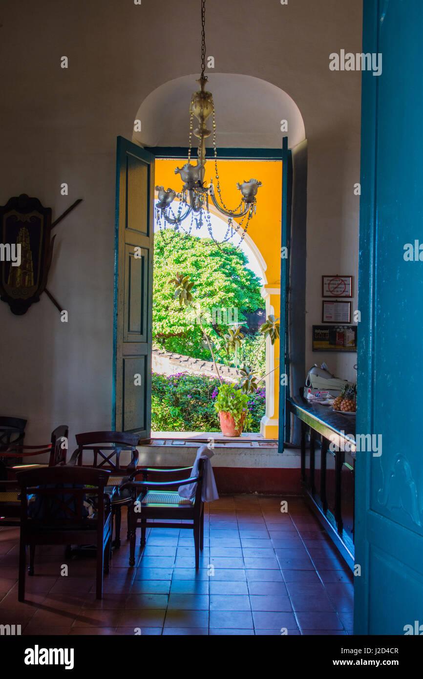 Cuba, Sancti Spiritus Province. Valle de los Ingenios. Manaca Iznaga Plantation. View through an open window. - Stock Image