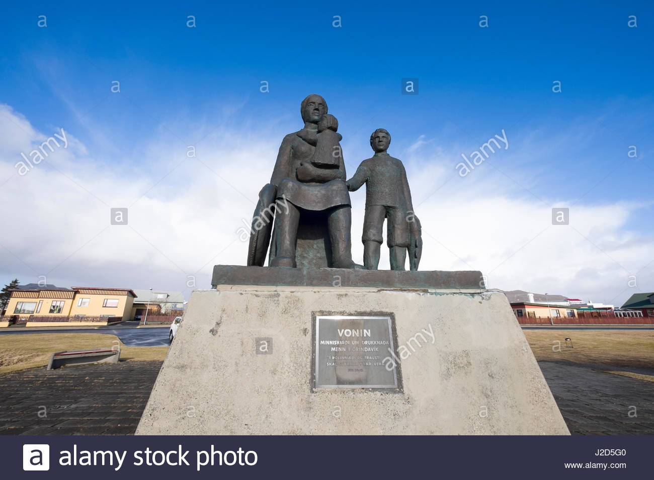 Statue of the bereaved dedicated to the families of local fishermen lost at sea, Grindavík, Southern Peninsula, - Stock Image