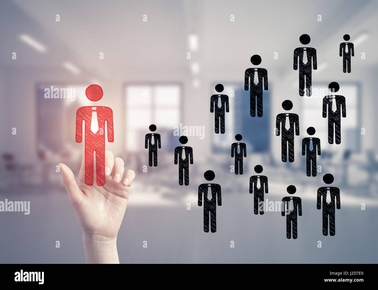 Concept of leadership and teamworking with many icons and one of - Stock Image