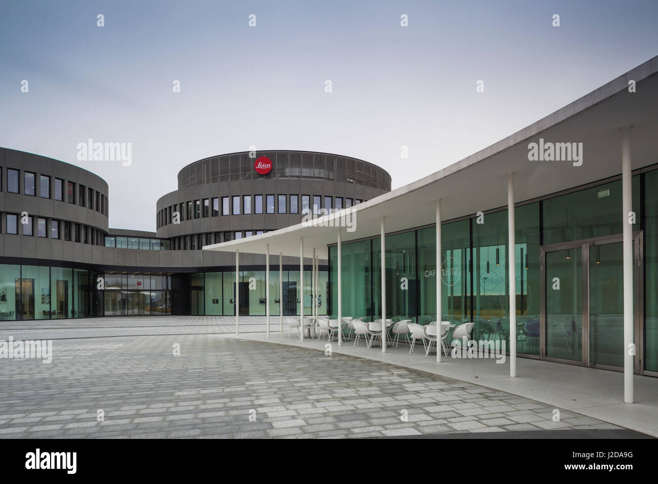 Germany, Hesse, Wetzlar, Headquarters of the Leica Camera Company, opened in 2014, exterior view with Cafe Leitz - Stock Image