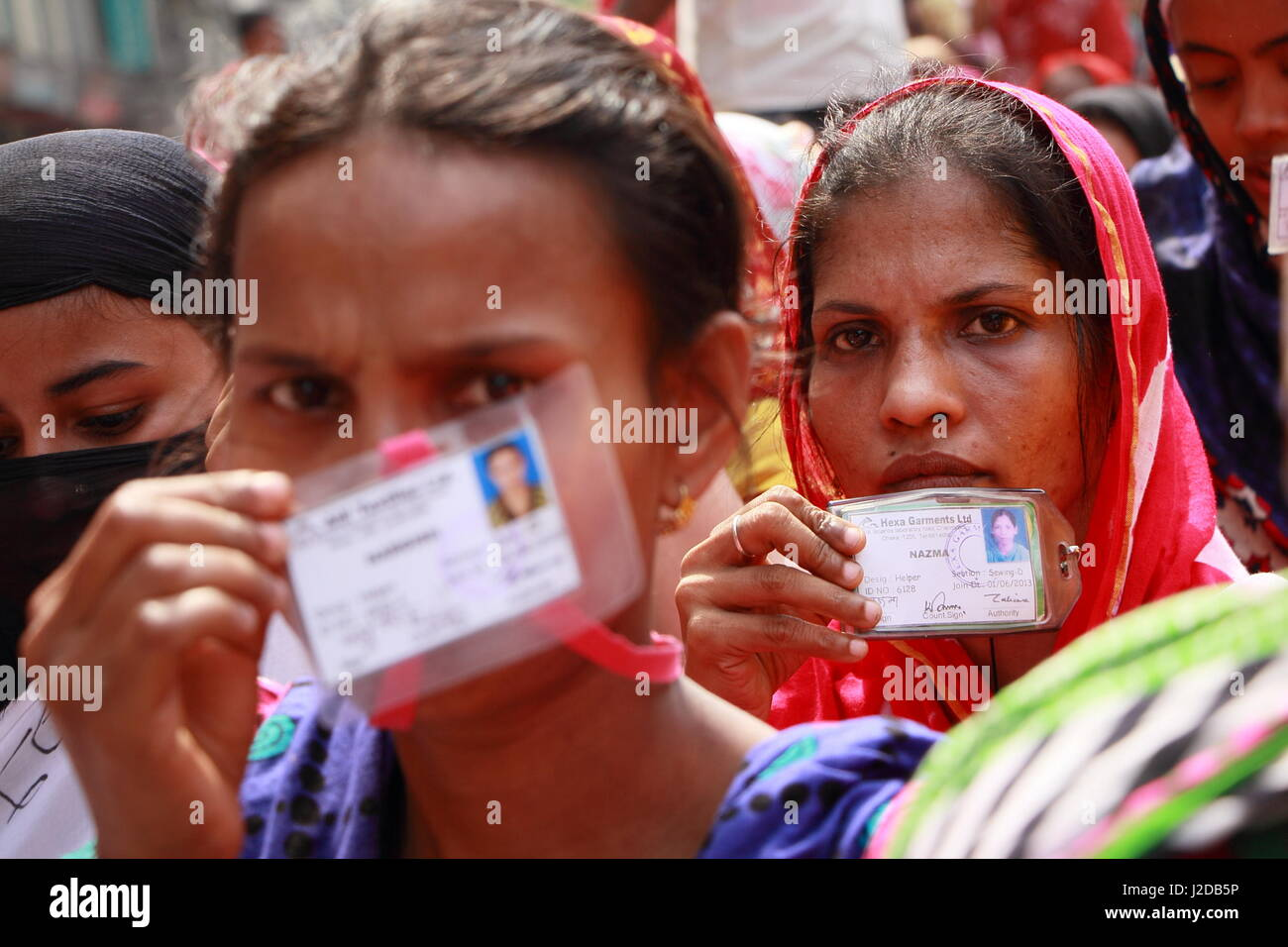 Dhaka, Bangladesh. 27th Apr, 2017. Two workers show ID cards during demonstrations in Dhaka, capital of Bangladesh, - Stock Image