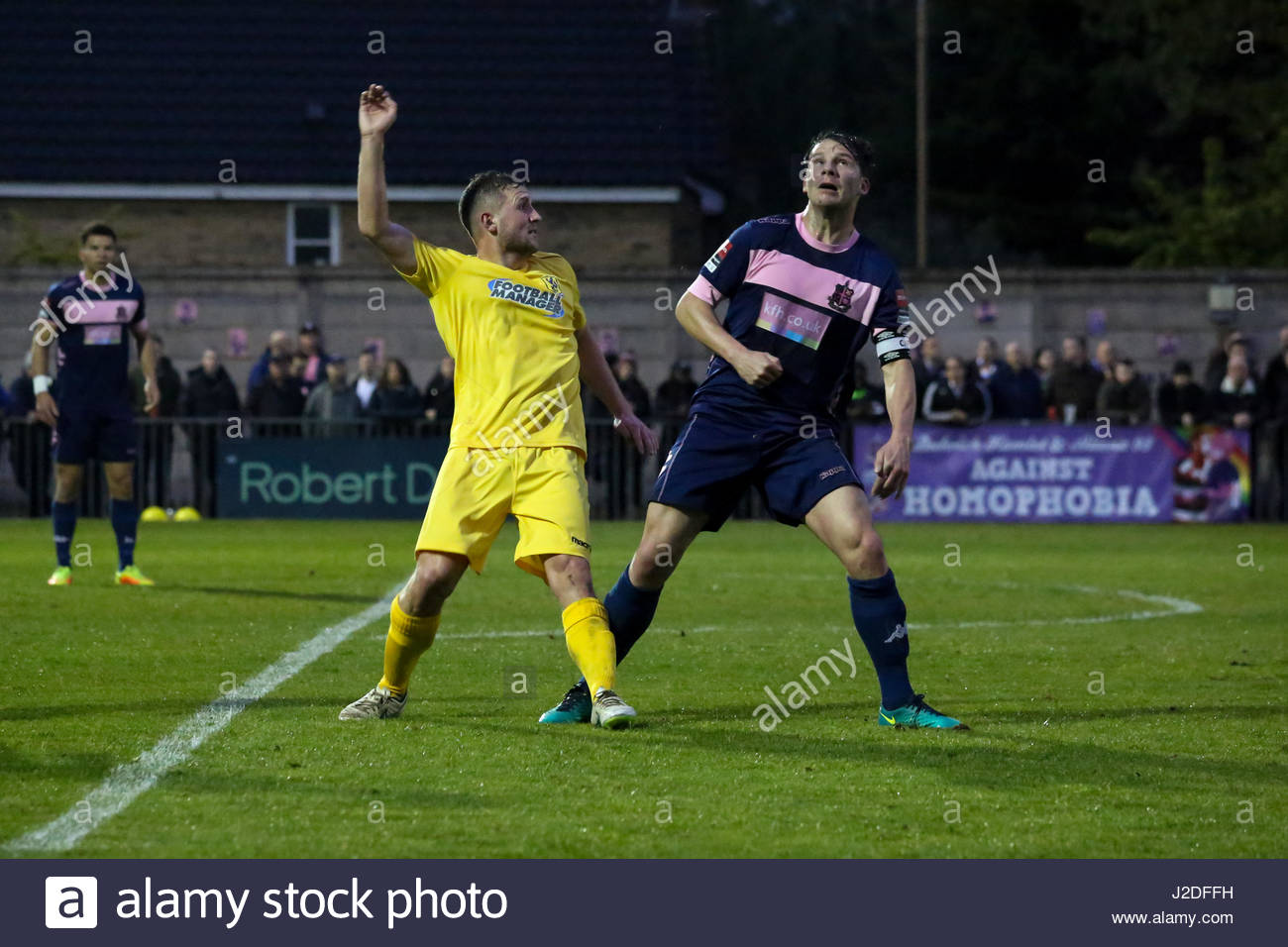 London, UK. 27th April, 2017. Billy Crook of Enfield Town and Kenny Beaney of Dulwich Hamlet during their Ryman - Stock Image