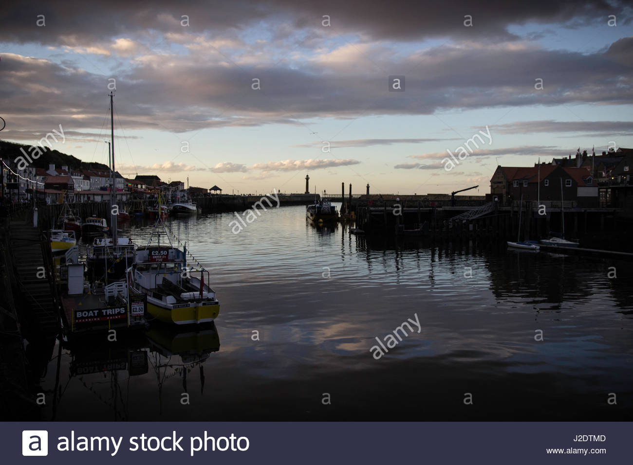 Whitby Harbour at dusk in low natural light - Stock Image