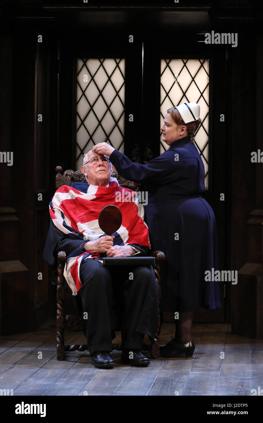 Ricahrd Wilson (L) performs as the headmaster, with Jenny Galloway as Matron in Alan Bennett's play 'Forty - Stock Image