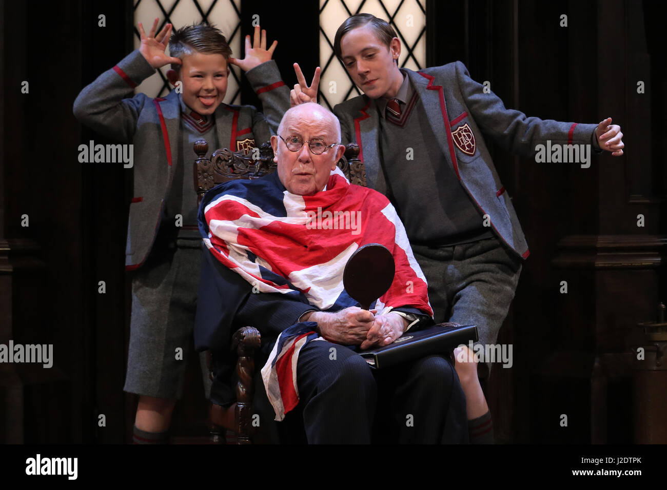 Ricahrd Wilson performs as the headmaster, with Cameron House and Alex Phillips as pupils in Alan Bennett's - Stock Image