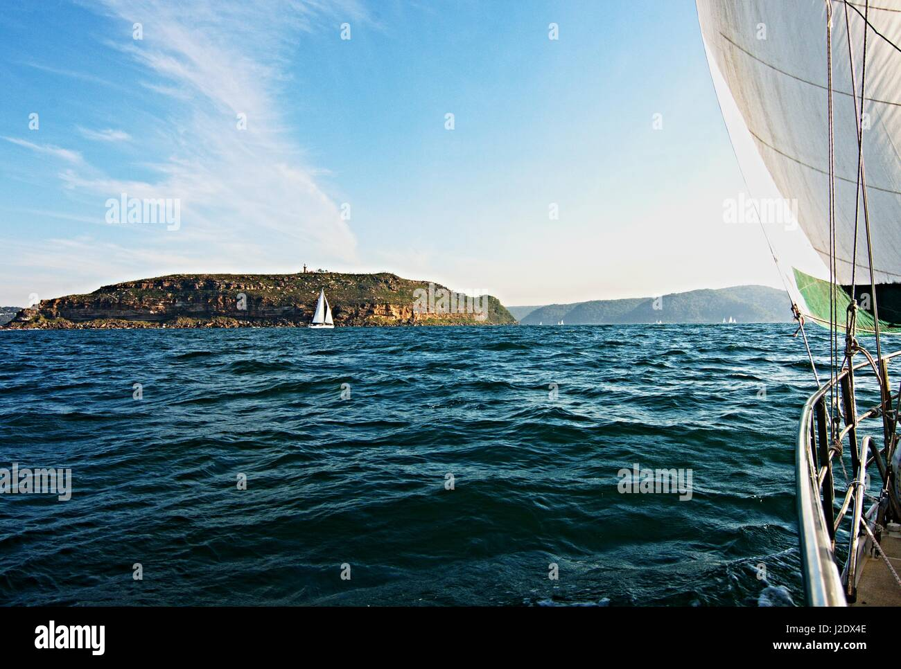 Cruising Sailing Yacht, under sail,  at sea heading to the safe harbour of Broken Bay, New South Wales, Australia. - Stock Image
