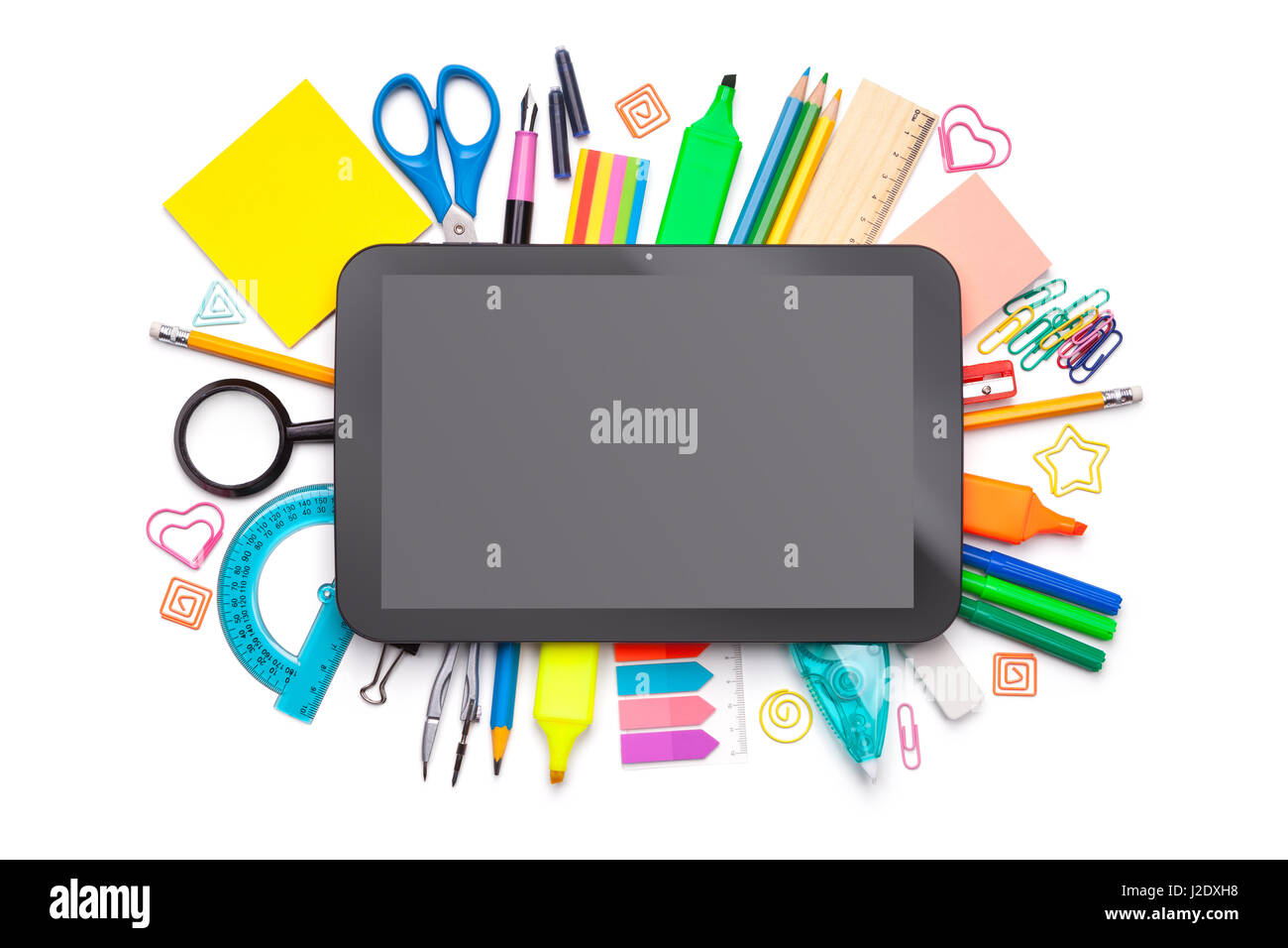 School concept. Tablet over school supplies isolated on white background. Top view - Stock Image