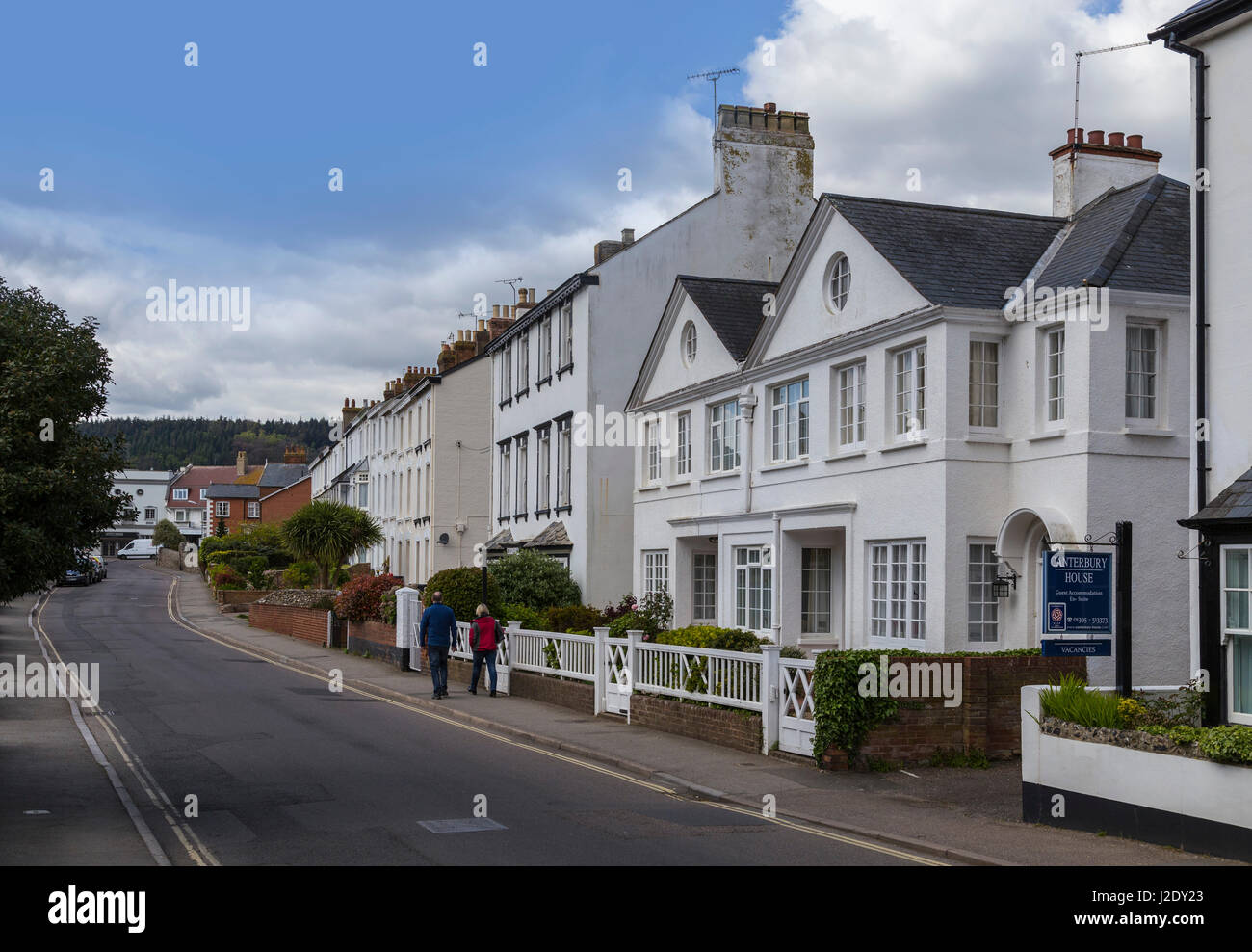 View along Salcombe Road in Sidmouth town centre, including the houses in Cambridge Terrace. - Stock Image