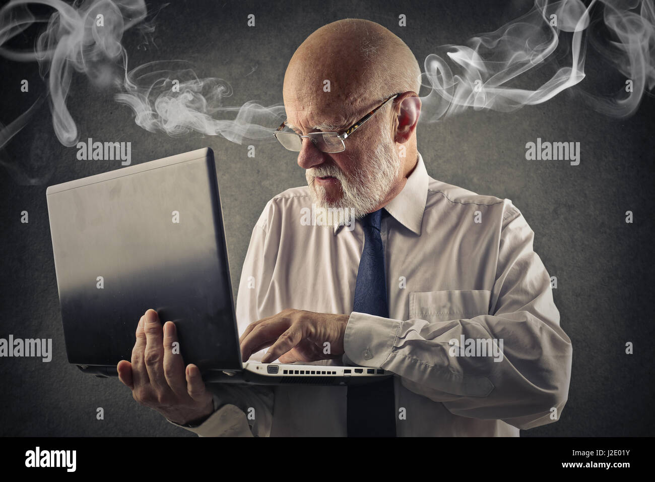 Mad businessman, steam coming out of his ears - Stock Image