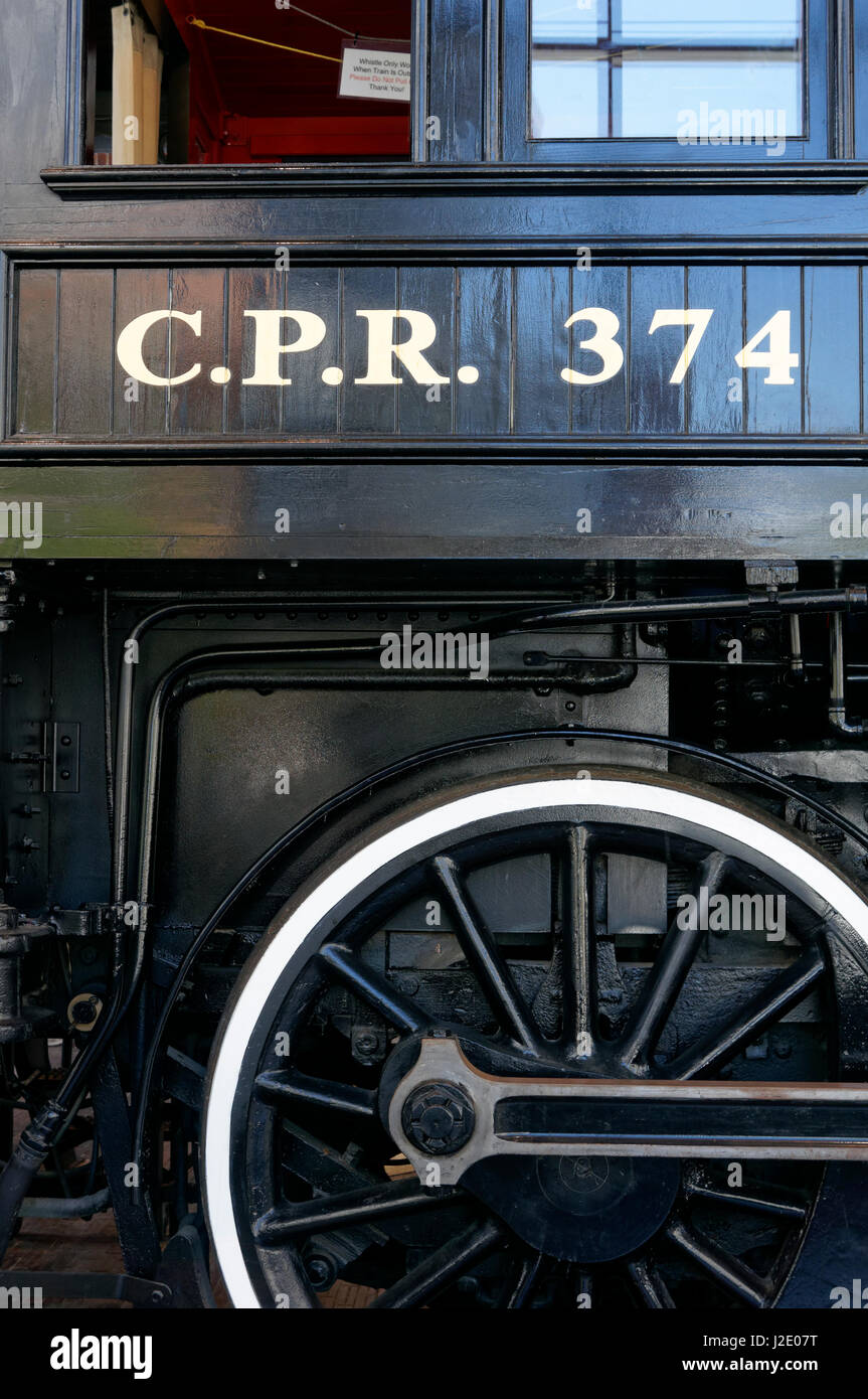 Drive wheel and cab of the Restored CPR Engine 374 at the Roundhouse in Yaletown, Vancouver, British Columbia, Canada. Stock Photo