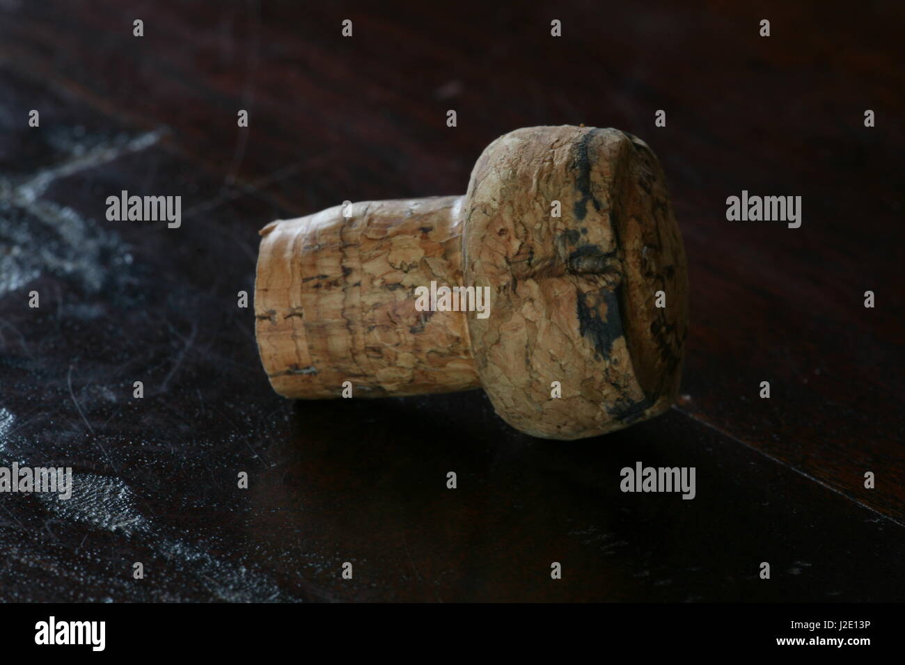cork on wooden table - Stock Image