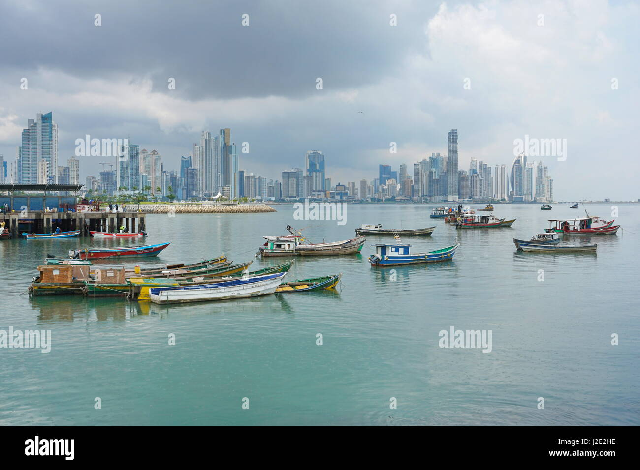 Panama city fishing boats anchored with skyscrapers buildings, Pacific coast, Central America - Stock Image