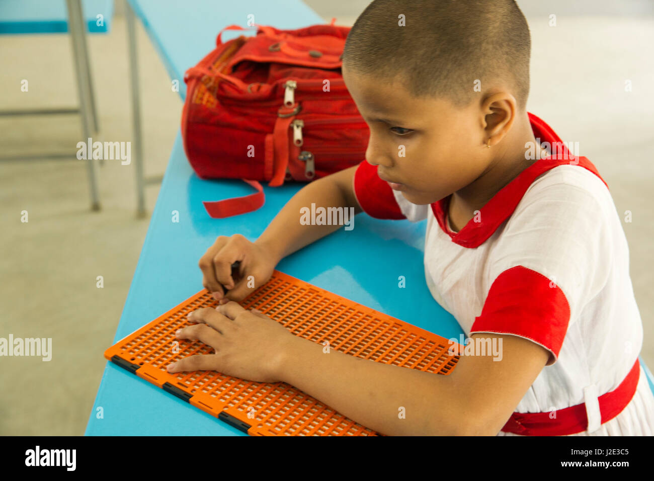 Visually impaired girl student learns in classroom with the help of Bangla braille at the Baptist Mission Integrated - Stock Image