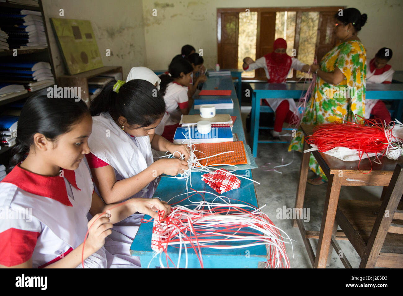 Visually impaired girl students make bags in the classroom at the Baptist Mission Integrated School in Mirpur. Dhaka, - Stock Image