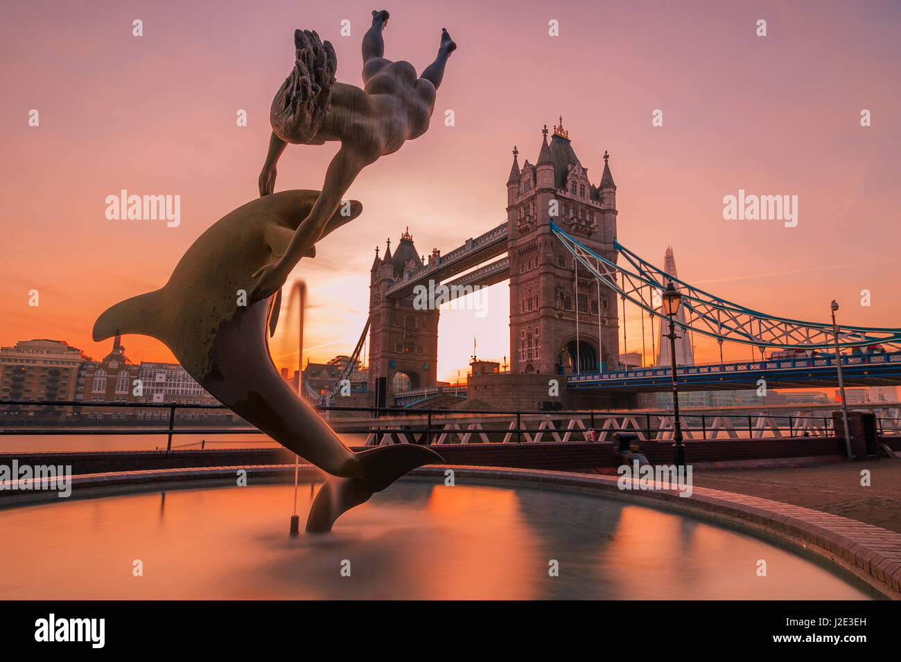 Photo of Girl with a Dolphin (1973), a sculpture by London's Tower Bridge by David Wynne. - Stock Image