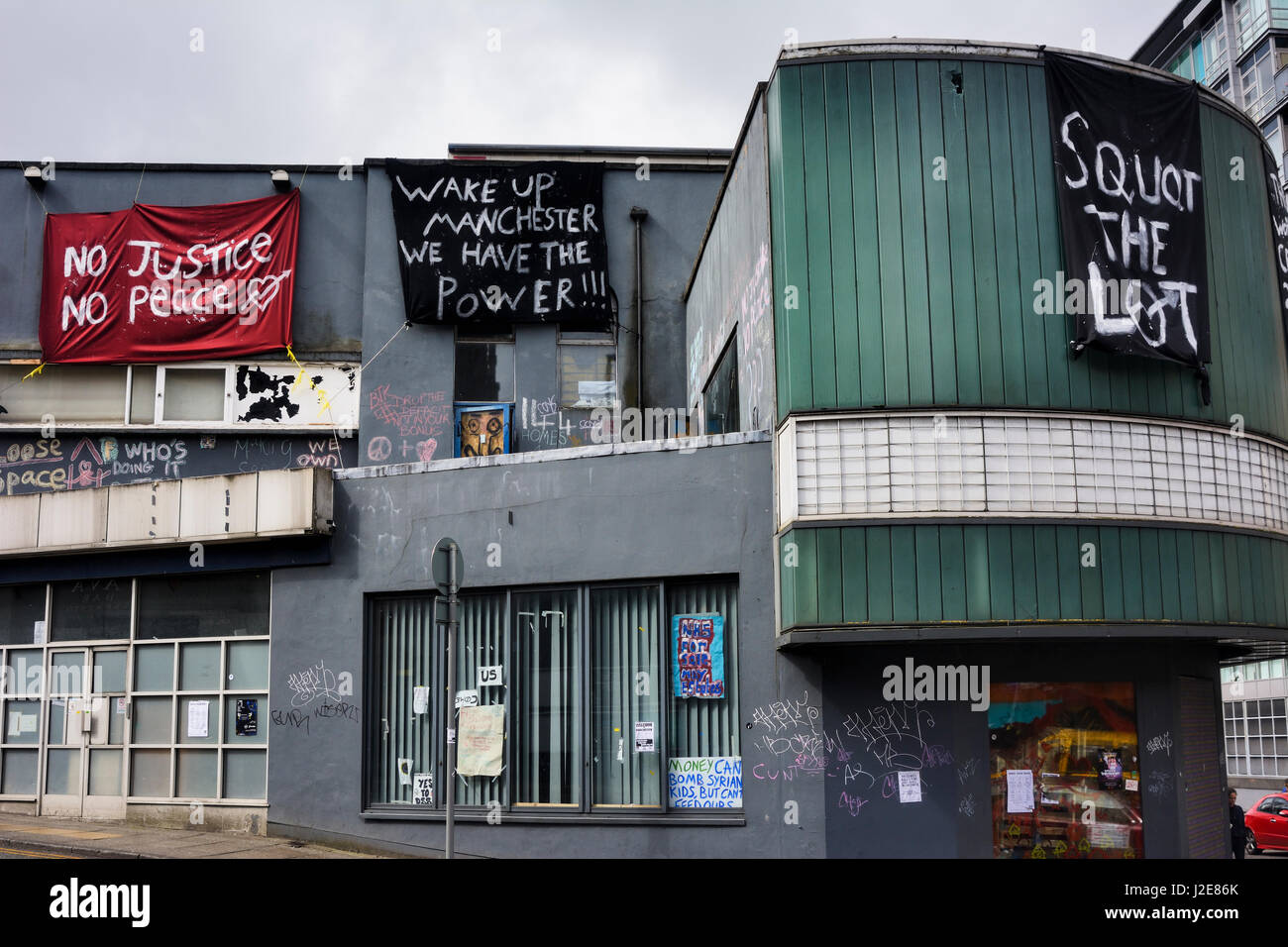 The Cornerhouse building, once a popular cinema at Oxford Road Railway Station taken over by squatters. - Stock Image