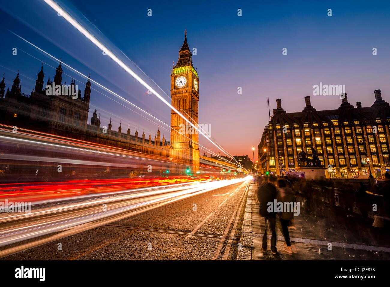 Light trails in front of Big Ben, dusk, evening light, sunset, Houses of Parliament, Westminster Bridge, City of - Stock Image