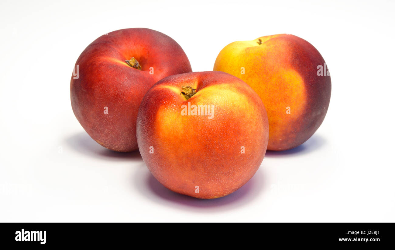 sweet freshness of nectarines, peach isolated on white background - Stock Image
