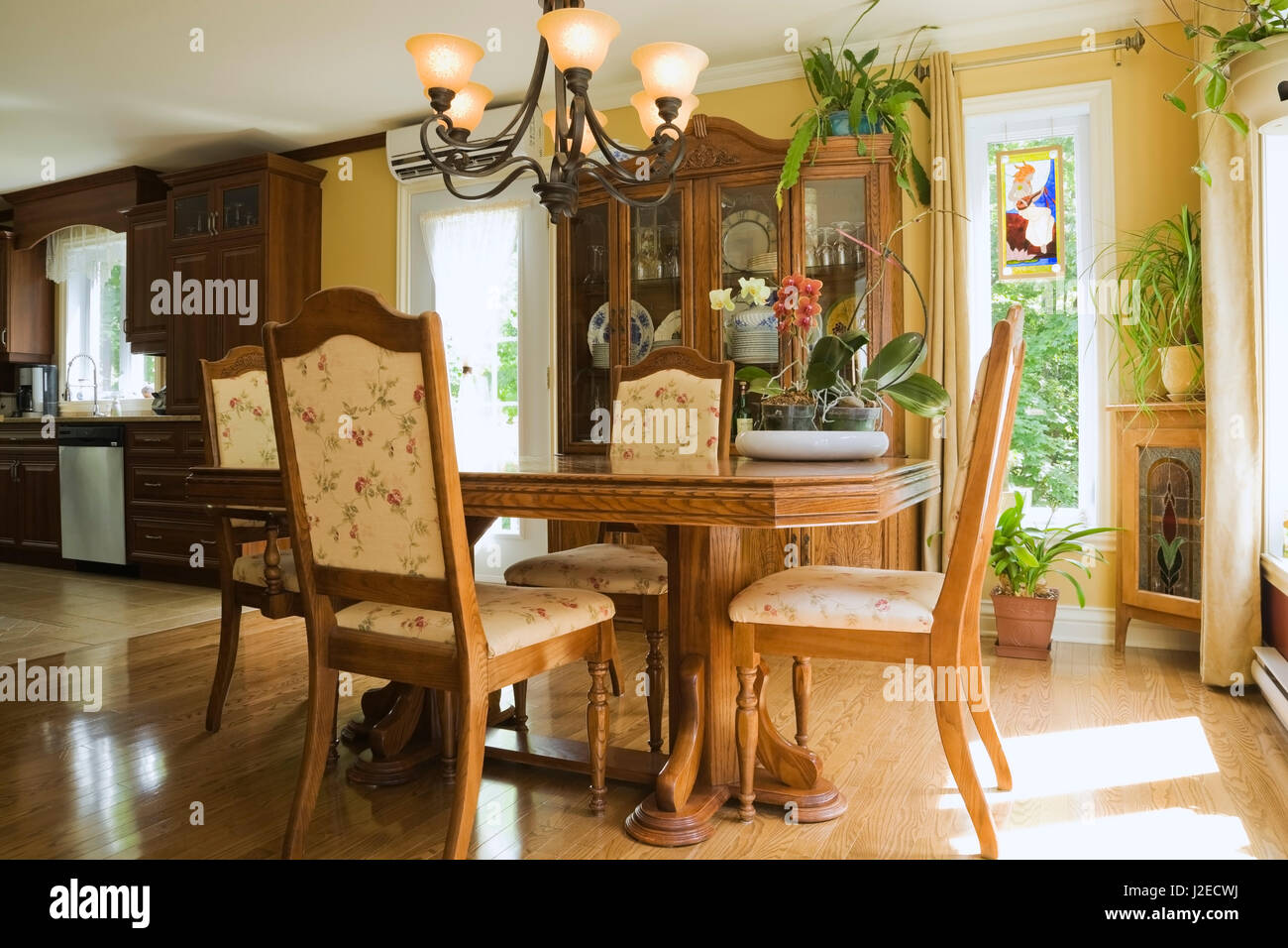 antique wooden dining table with upholstered chairs in the dining rh alamy com
