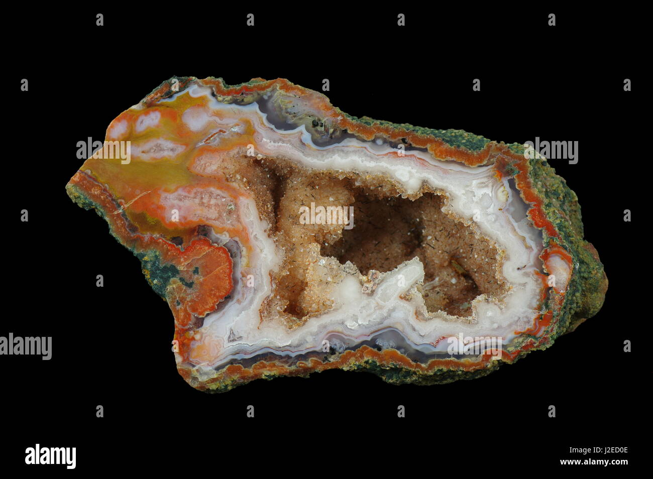 A cross section of the agate stone. Inside geode is a 'calcite brush' with goethite. Origin: Asni, Atlas - Stock Image