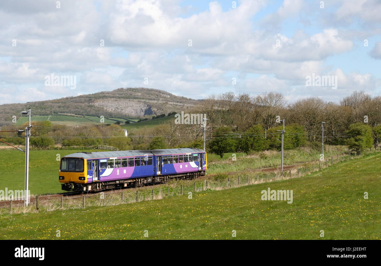 Pacer class 144 diesel multiple unit train In Northern livery in countryside on West Coast Main Line between Bolton - Stock Image