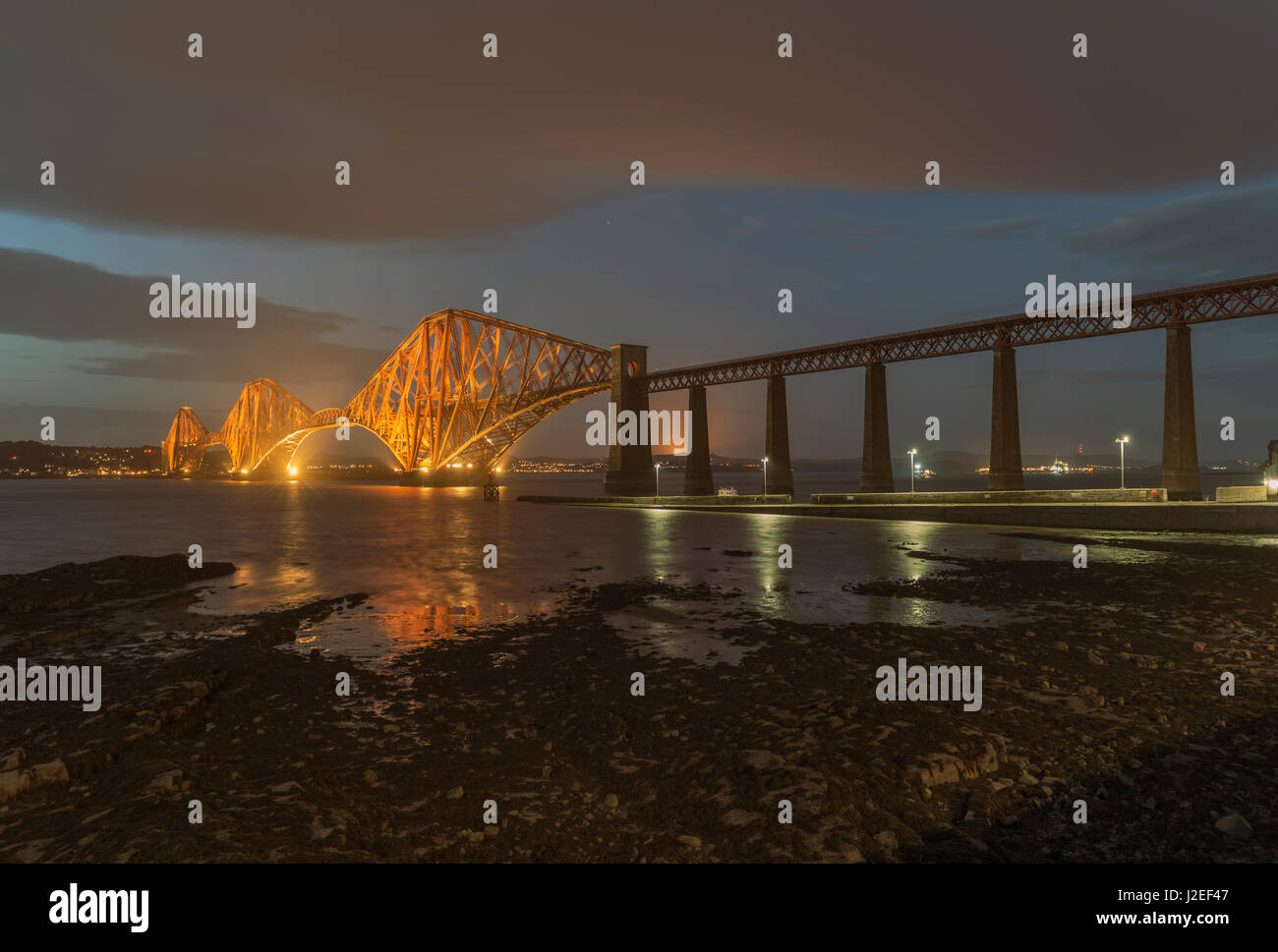 Forth Bridge at dusk looking north, South Queensferry, Lothian, Scotland, United Kingdom - Stock Image