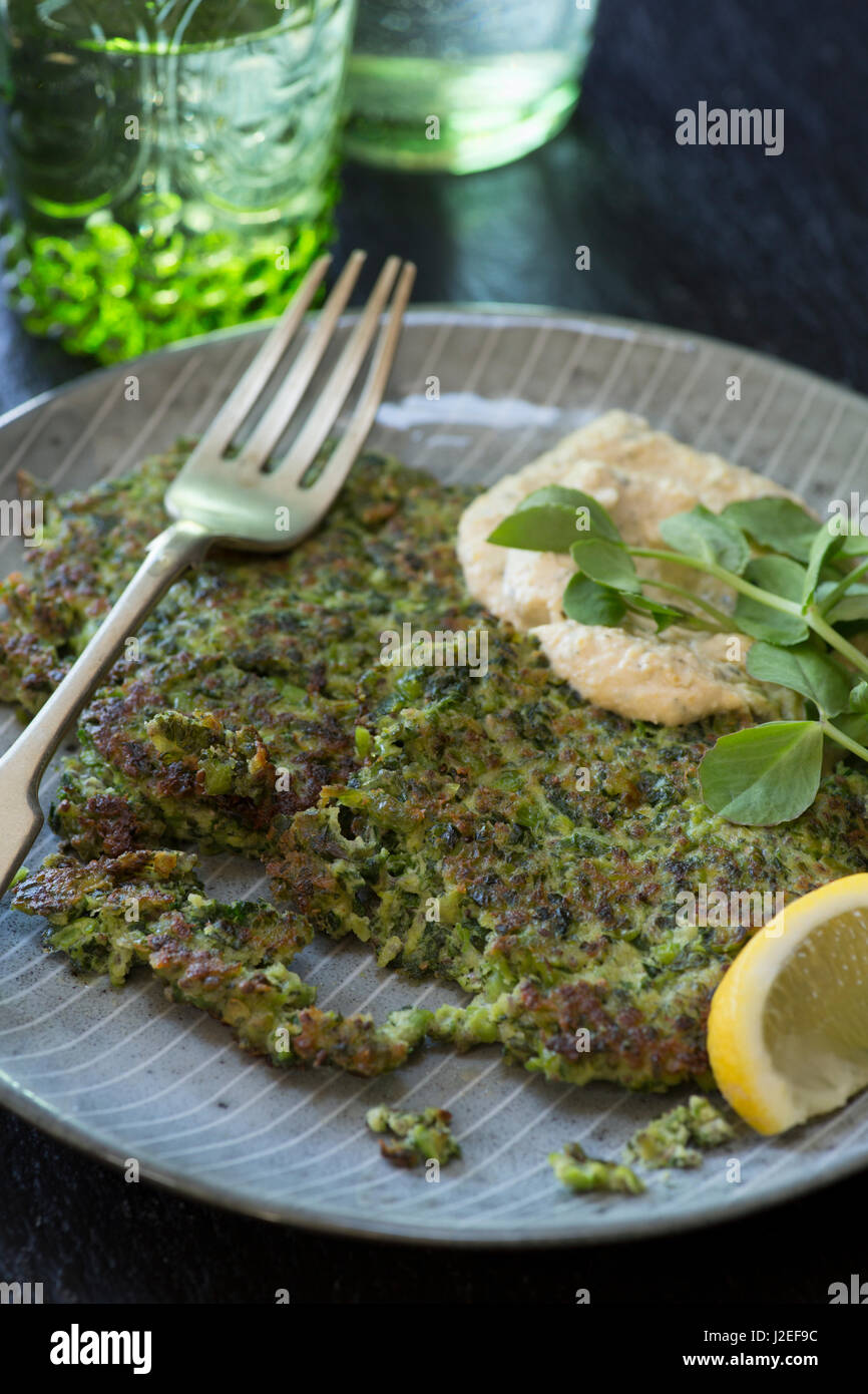 Kale and pea fritters with humous Stock Photo