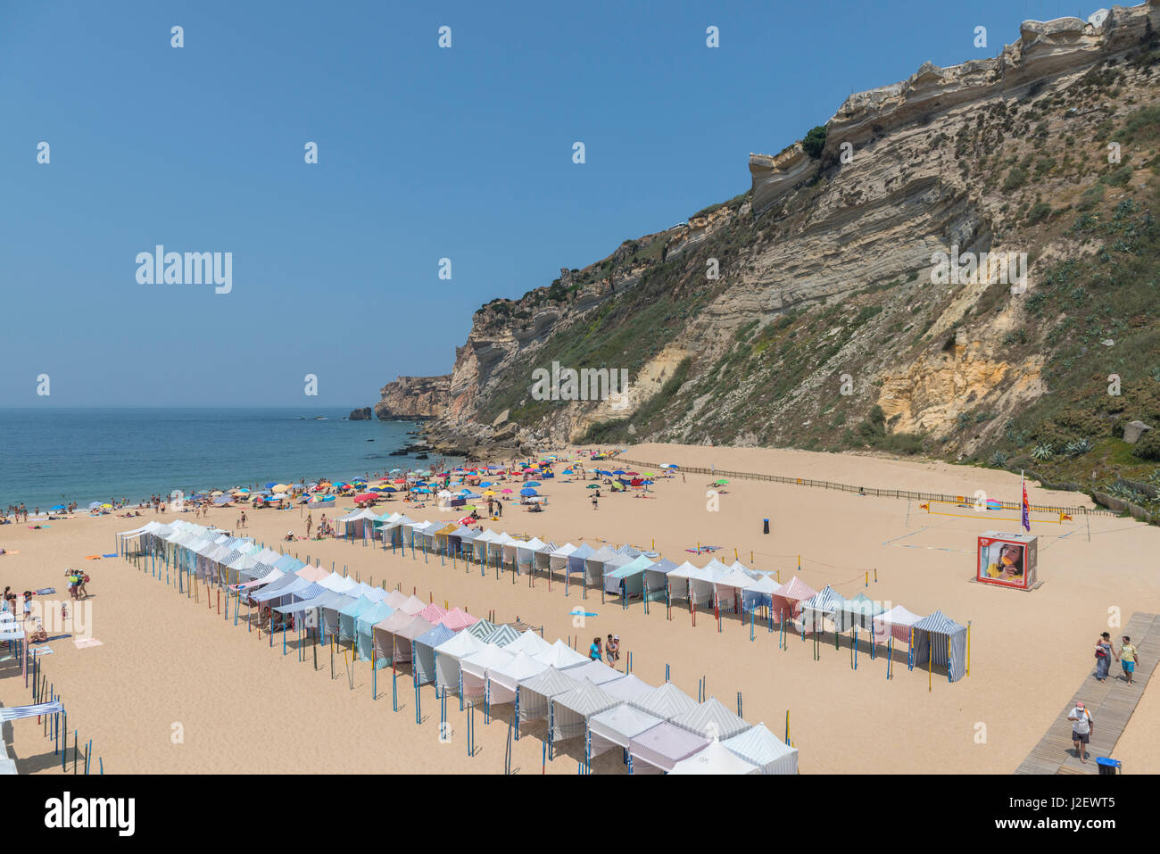 Portugal, Nazare, striped cabanas on beach (Large format sizes available) Stock Photo
