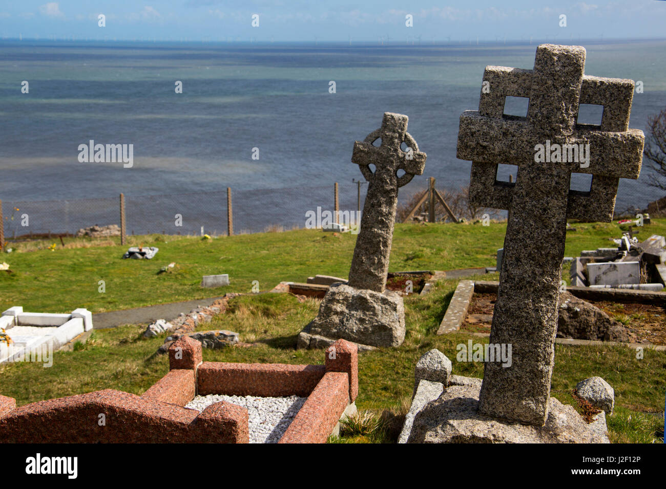 United Kingdom, Wales, Colwyn. Celtic crosses at St. Tudno churchyard on the Great Orme, Wales. Stock Photo