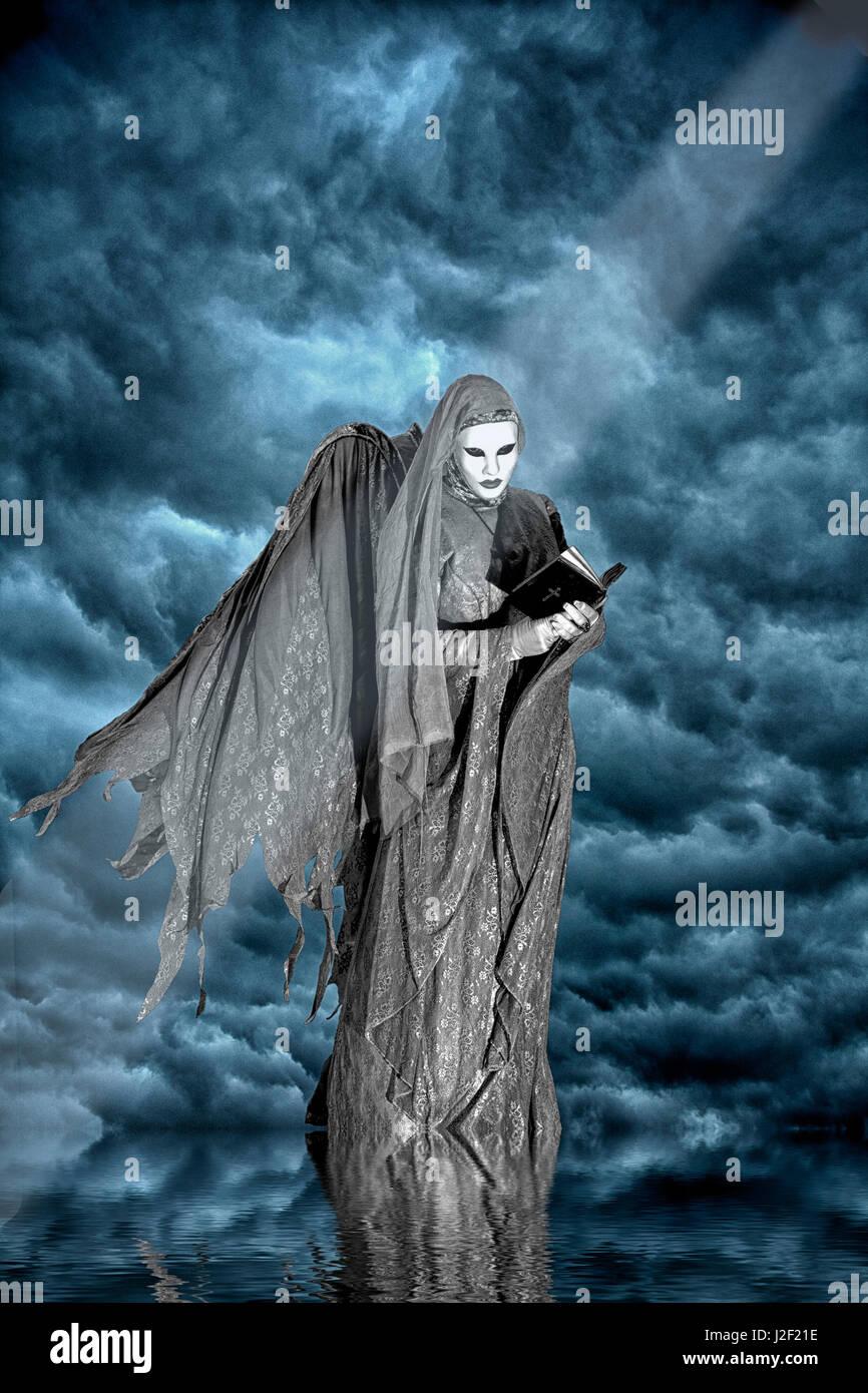 Artistic creation of dark angel and clouds. Credit as: Jim Zuckerman / Jaynes Gallery / DanitaDelimont.com - Stock Image