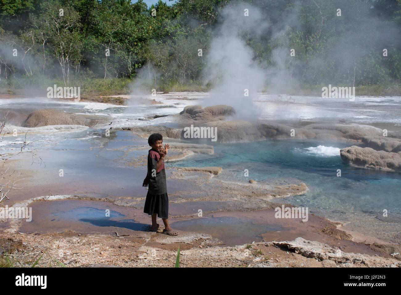 Melanesia, Papua New Guinea, Fergusson Island, Del Hot Springs. Volcanic hot springs. Local woman who 'calls' - Stock Image