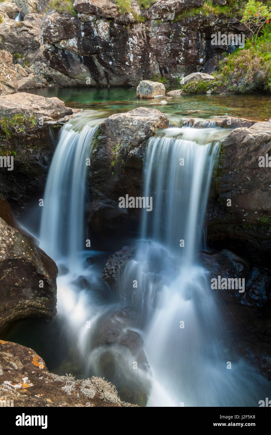 One of the rivers that from the Black Cuillins mountains flows down is characterized by the many waterfalls and - Stock Image