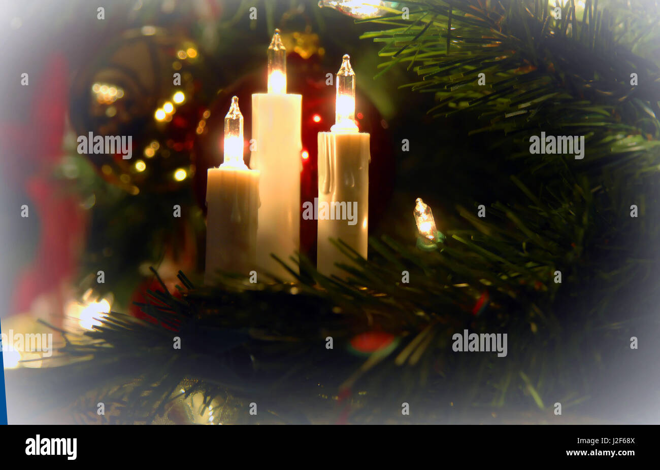 Electric Christmas Candles.Three Electric Candles Spread A Warm Glow On A Christmas