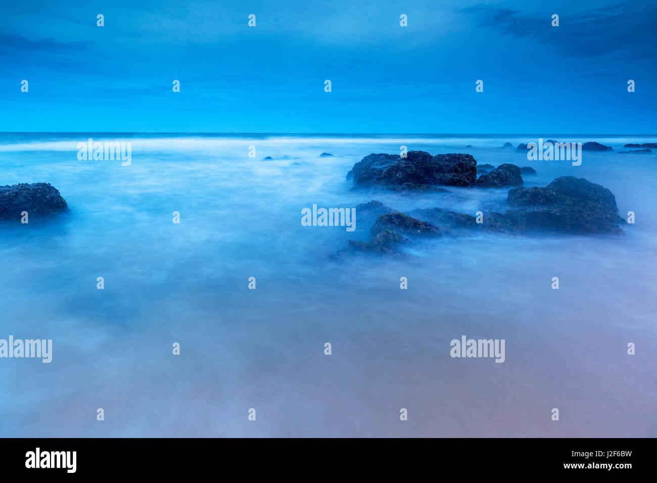 The blue hour at the beach of Mui Ne - Stock Image